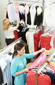 Young woman at apparel shopping — Stock Photo