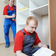 Wardrobe joiners at installation work — Stock Photo #21718083