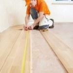 Carpenter worker joining parket floor — Stock Photo