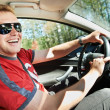 Happy driver driving car — Stock Photo