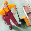 Waregouse worker with fork pallet truck — Stock Photo #21718913