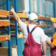 Warehouse workers at storehouse — Stock Photo