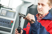Worker measuring tool by hand caliper — Stock Photo