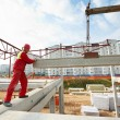 Stock Photo: Builder worker installing concrete slab