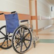 Wheelchair for disabled paients in clinic - Stock Photo