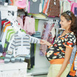 Young pregnant woman at shop — Foto de Stock