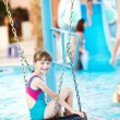 Royalty-Free Stock Photo: Smiling child in resort swimming pool