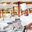 Arab chef with food at restaurant hotel - Stock Photo