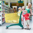 Royalty-Free Stock Photo: Woman and children making shopping