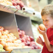 Child boy choosing fruits vegetable shopping — Stock Photo