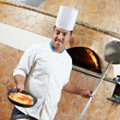 Stock Photo: Arab baker chef making Pizza