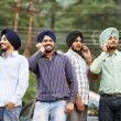 Young indian sikh men with mobile phones — Stock Photo