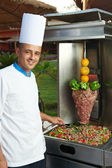 Arab chef making kebab — Stock Photo