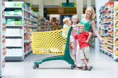 Woman and children making shopping — Stock Photo