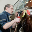 Auto mechanic polishing car — Stock Photo