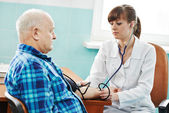 Nurse at Blood pressure medic test — Stockfoto