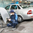 Auto mechanic polishing car — Stock Photo #22826498