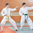 Two man at taekwondo exercises - Stock Photo
