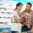 Royalty-Free Stock Photo: Family choosing food at shopping in supermarket