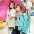 Woman and little girl shopping clothes — Stock Photo #23239902