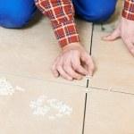 Tiler hands at home renovation work — Stock Photo #23428242