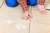 Tiler hands at home renovation work — Stock Photo