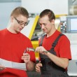 Industrial workers at tool workshop — Stock Photo #23473326