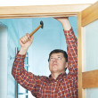 Carpenter at door installation - Stock Photo
