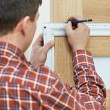 Stock Photo: Carpenter at door installation