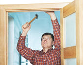 Carpenter at door installation — Stock Photo
