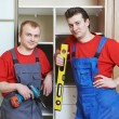 Portrait of wardrobe installation carpenters — Stock Photo