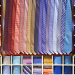 Ties collection on the shelf of a shop — Stock Photo