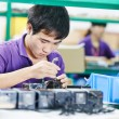 Stock Photo: Chinese male worker at manufacturing