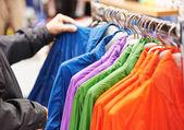 Close-up hands choosing clothing — Stock Photo