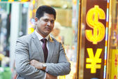 Smiling young indian businessman — Stock Photo