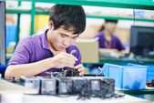 Chinese male worker at manufacturing — Stock Photo