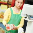 Chinese woman shop worker - Stock Photo