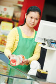 Chinese woman shop worker — Stock Photo
