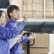Two chinese workers in warehouse — Stock Photo