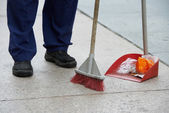 Street cleaning and sweeping with broom — Stock Photo