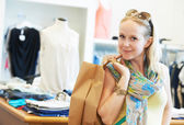 Young woman at apparel clothes shopping — Fotografia Stock