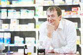 Confident pharmacy chemist man in drugstore — Stockfoto