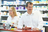 Pharmacy chemist workers in drugstore — Stock Photo