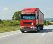 Red lorry with trailer on highway — Stock Photo