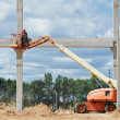 Builder worker stop up concrete pole — Stock Photo