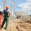 Two builders at construction site — Stock Photo