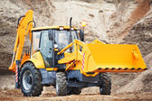 Loader excavator with risen shovel — Stock Photo