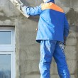 Stock Photo: Facade worker plastering wall