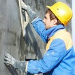 Foto Stock: Worker at plastering facade work