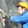 Builder worker at plastering facade work — Stock Photo #30037989